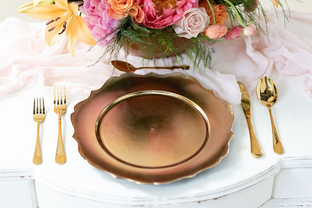 At Last Wedding gold flatware and charger rental