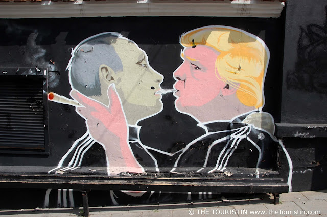 Mural with Trump and Putin smoking a joint by Mindaugas Bonanu in Vilnius in Lithuania