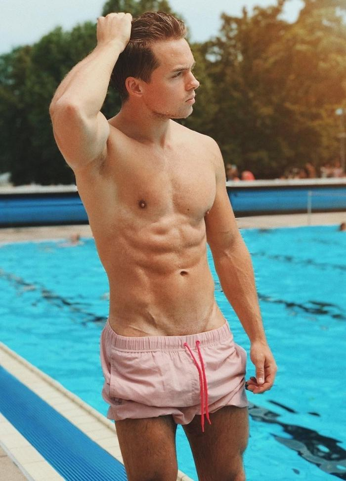 handsome-male-model-pool-shirtless-pose