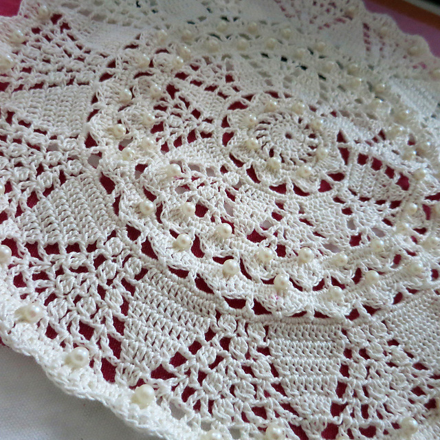 White lace doily with beads