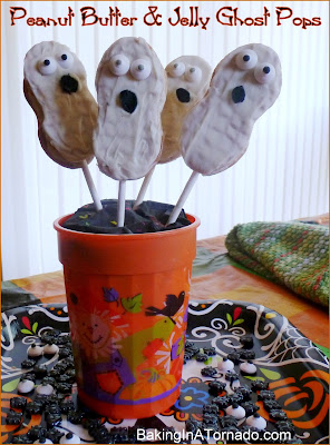 Peanut Butter and Jelly Ghost Pops, a fun Halloween craft/treat | Recipe developed by www.BakingInATornado.com | #recipe #Halloween #Snack