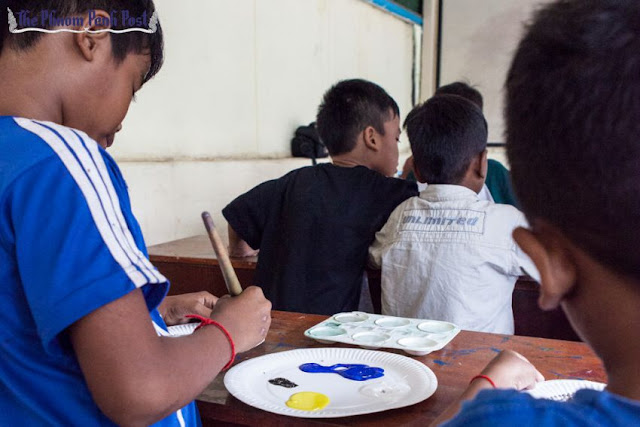 Children take part in a painting activity earlier this year at a Phnom Penh orphanage. Athena Zelandonii