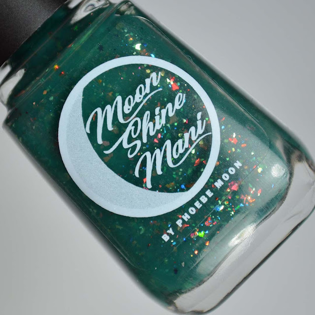 green nail polish with flakies in a bottle