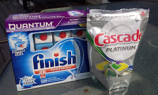 Package of Finish Powerball next to package of Cascade Platinum dishwasher pacs