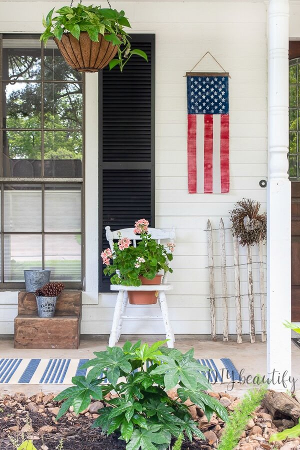 patriotic flag banner on porch