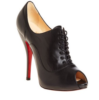 9081c3352441 Louboutin s Lady Derby in black with trademark red sole.