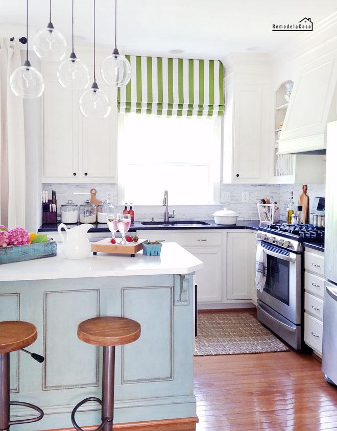 white kitchen, bar stools, sisal rug, blue island