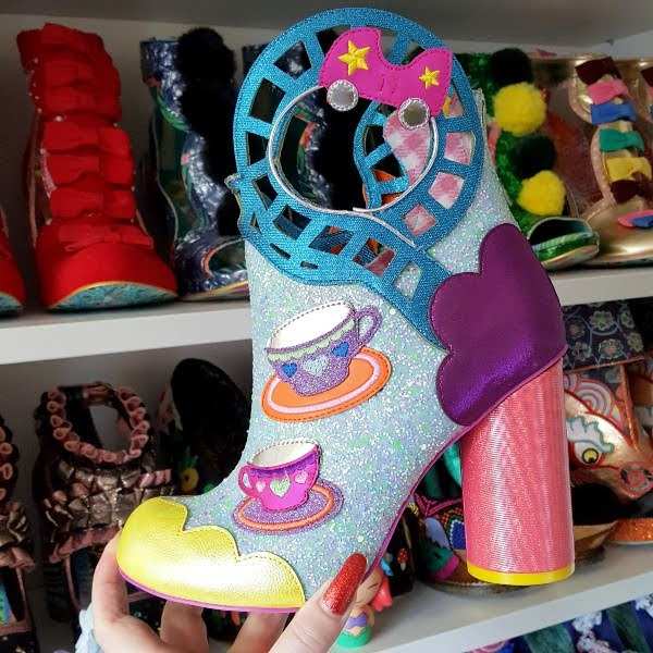 rollercoaster themed glitter ankle boots with shoe shelves in background
