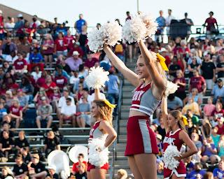 Cheerleader at football game | hearing test near St. Johns MI