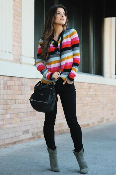 21+ Non-Boring Fall Outfits for Work | Multicolor Sweater + Levi's Skinny Jeans + Booties