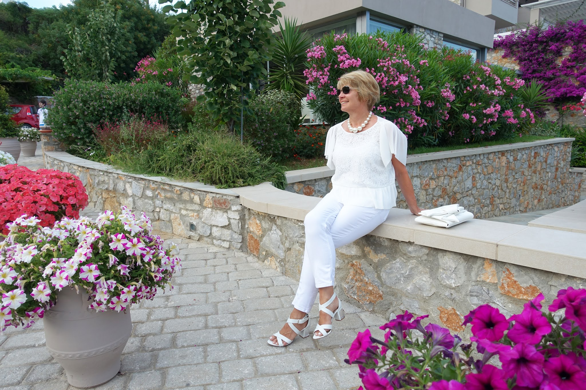 Is This Mutton style blogger Gail Hanlon in the gardens of the Kassandra Bay Hotel, Skiathos, Greece