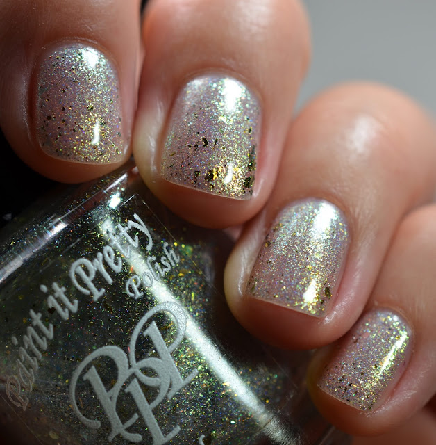 shimmery white nail polish that shifts to green and gold
