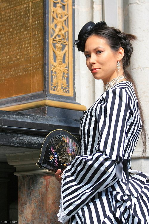 Woman wearing her black and white striped dress outfit.. Street style fashion,