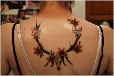 Attractive-Lily-on-Horns-Tattoo-Designs