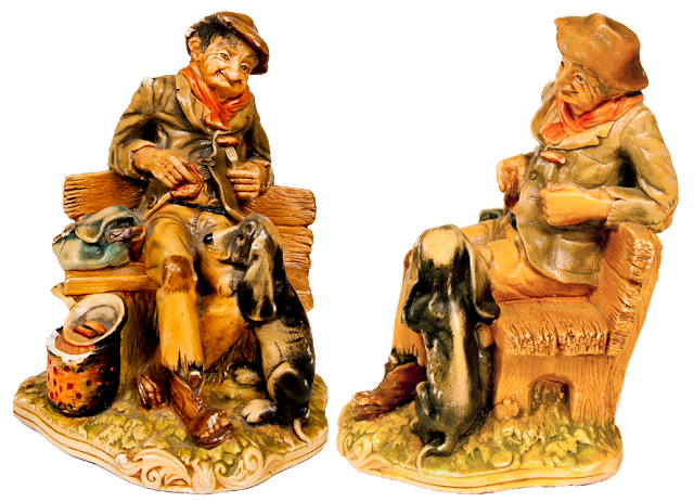 An old tramp figurine from Britain with the old man on a bench sharing his dinner with a hound.