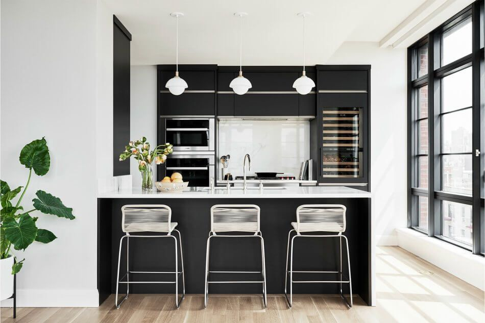 Small black kitchen with built in appliances