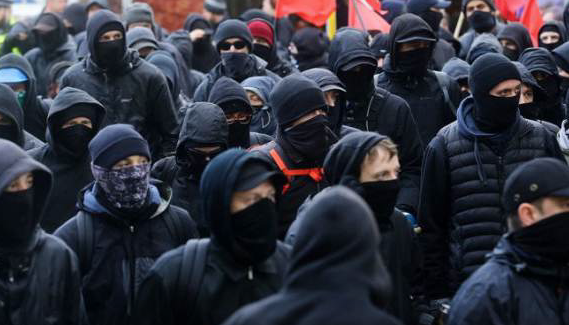 Antifa Website Shows How To Injure Police, Hold Up Banks, Sneak Across The Border, & More