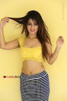 Cute Telugu Actress Shunaya Solanki High Definition Spicy Pos in Yellow Top and Skirt  0502.JPG
