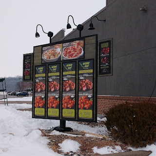 menu board at the Sioux City Fazoli's restaurant displayed before the restaurant's opening, primarily highlighting wings