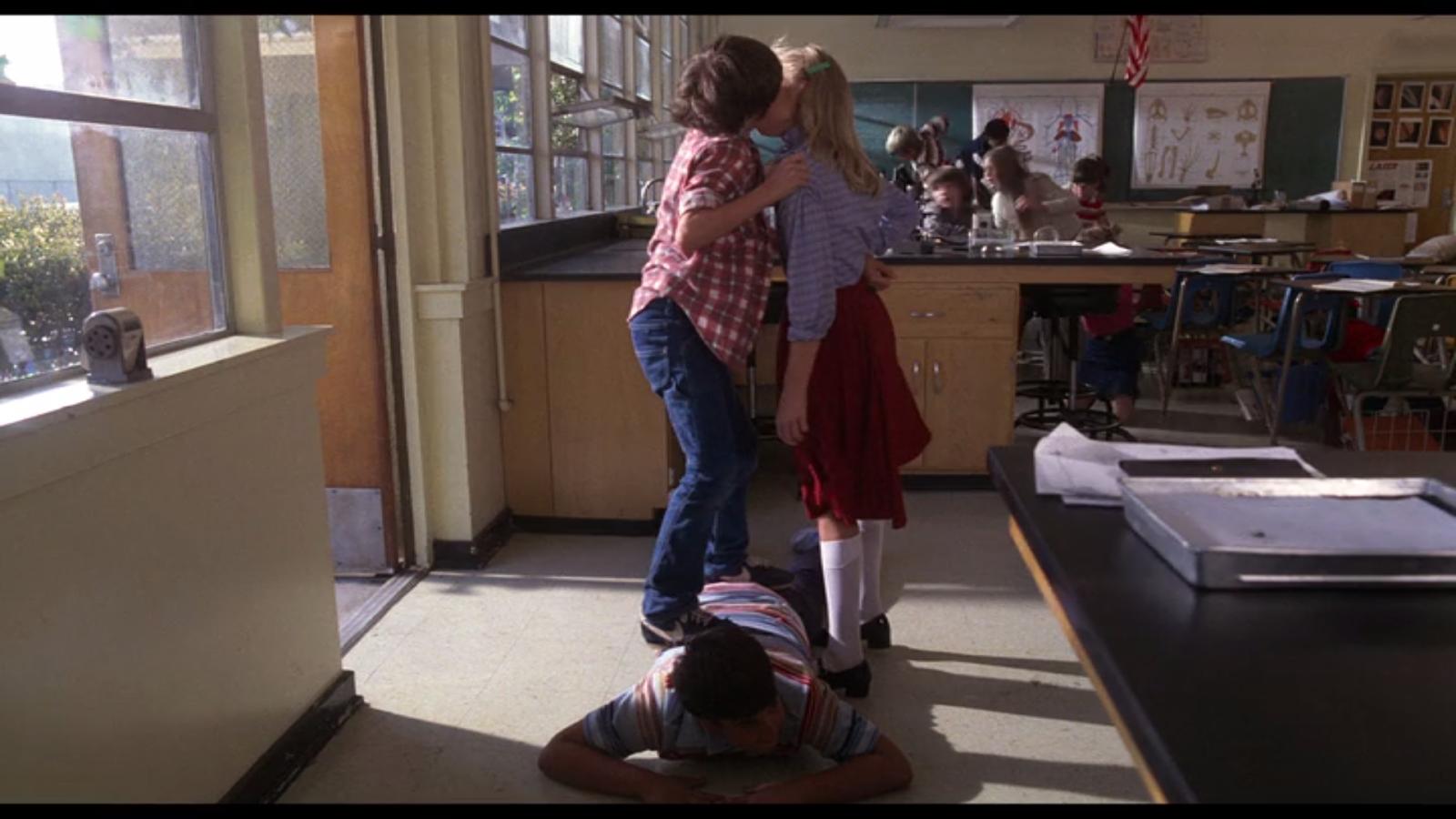 Elliot kisses a classmate