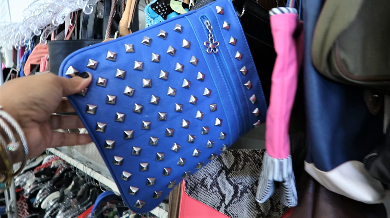 "Bought a blue rhinestone purse from the thrift store. Who goes to the thrift store and not rummage through the handbags? Not me says the best thrift snooper in the world. lolol"")  My luck changed right before I walked out the door with nothing in my hands. For only $3.99, I grabbed the cutest little blue rhinestone clutch bag I've ever seen."
