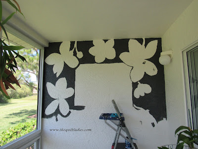 Hand painted flowers on a stucco wall on a condo lanai