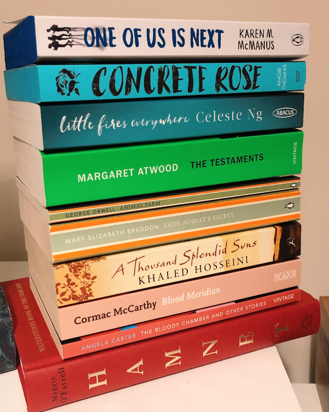Stack of books with spines facing the camera