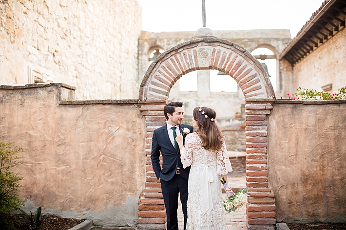 Team Of Wedding Pros Photography Theresa Bridget Venue Mission San Juan Capistrano In Dress Kite And Erfly