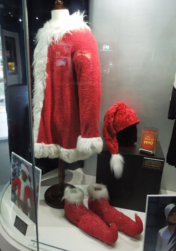 The Grinch Santa suit and The Book of Who prop