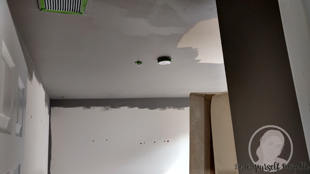 Painting ceiling.
