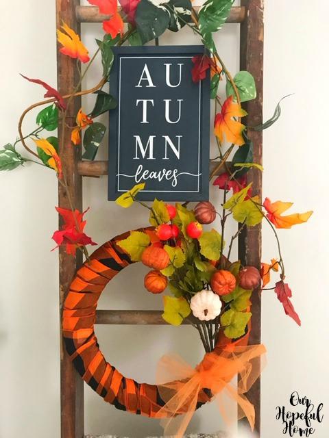 farmhouse ladder autumn leaf garland orange black buffalo plaid scarf wreath pumpkins