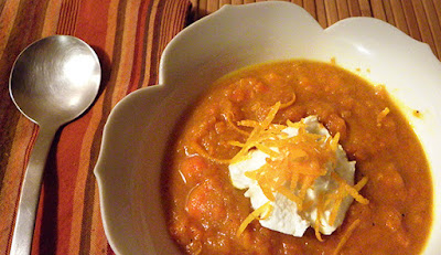 soup in bowl topped with yogurt
