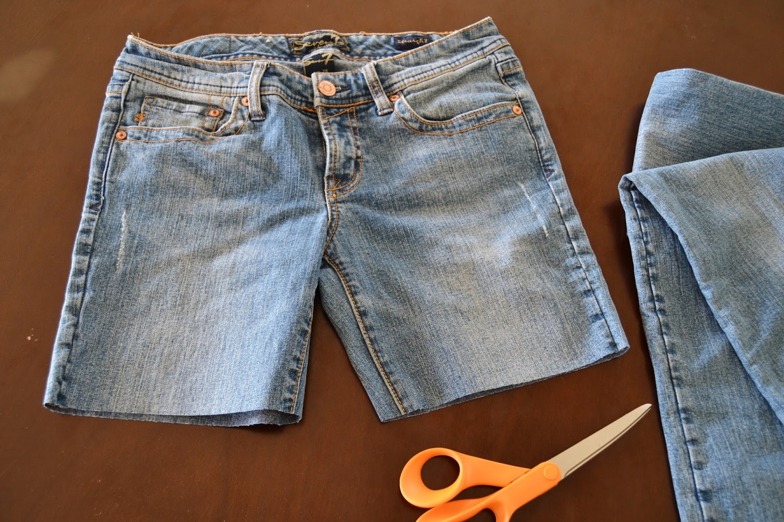 9cf51bbe6a I started with an old pair of jeans that I hadn't worn in years. I tried  them on, found where I wanted my skirt to hit and then made a mark about ...