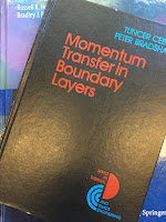 Momentum Transfer in Boundary Layers, by Tuncer Cebeci and Peter Bradshaw, superimposed on Intermediate Physics for Medicine and Biology.