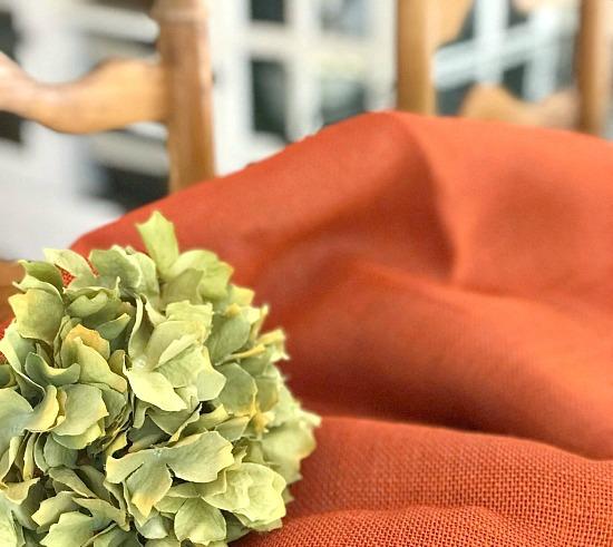 orange burlap and a hydrangea