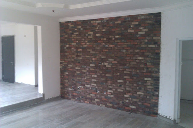 antique bricks done on interior tv wall