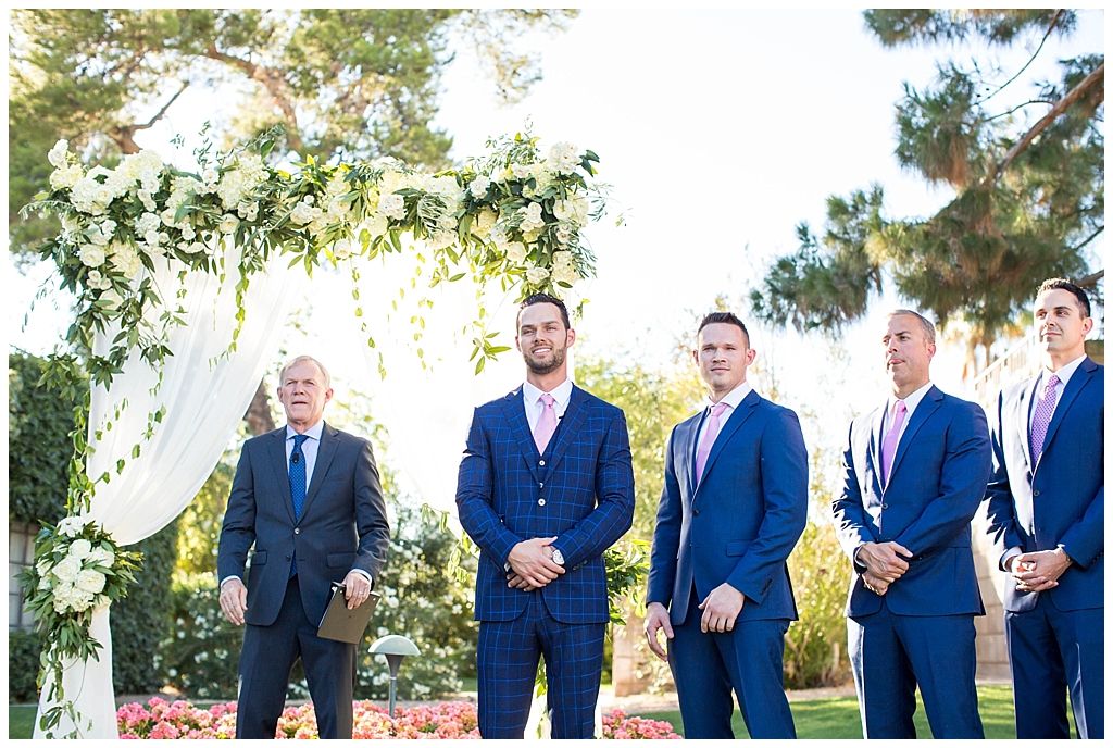 groom wearing custom blue suit seeing bride arizona biltmore wedding ceremony