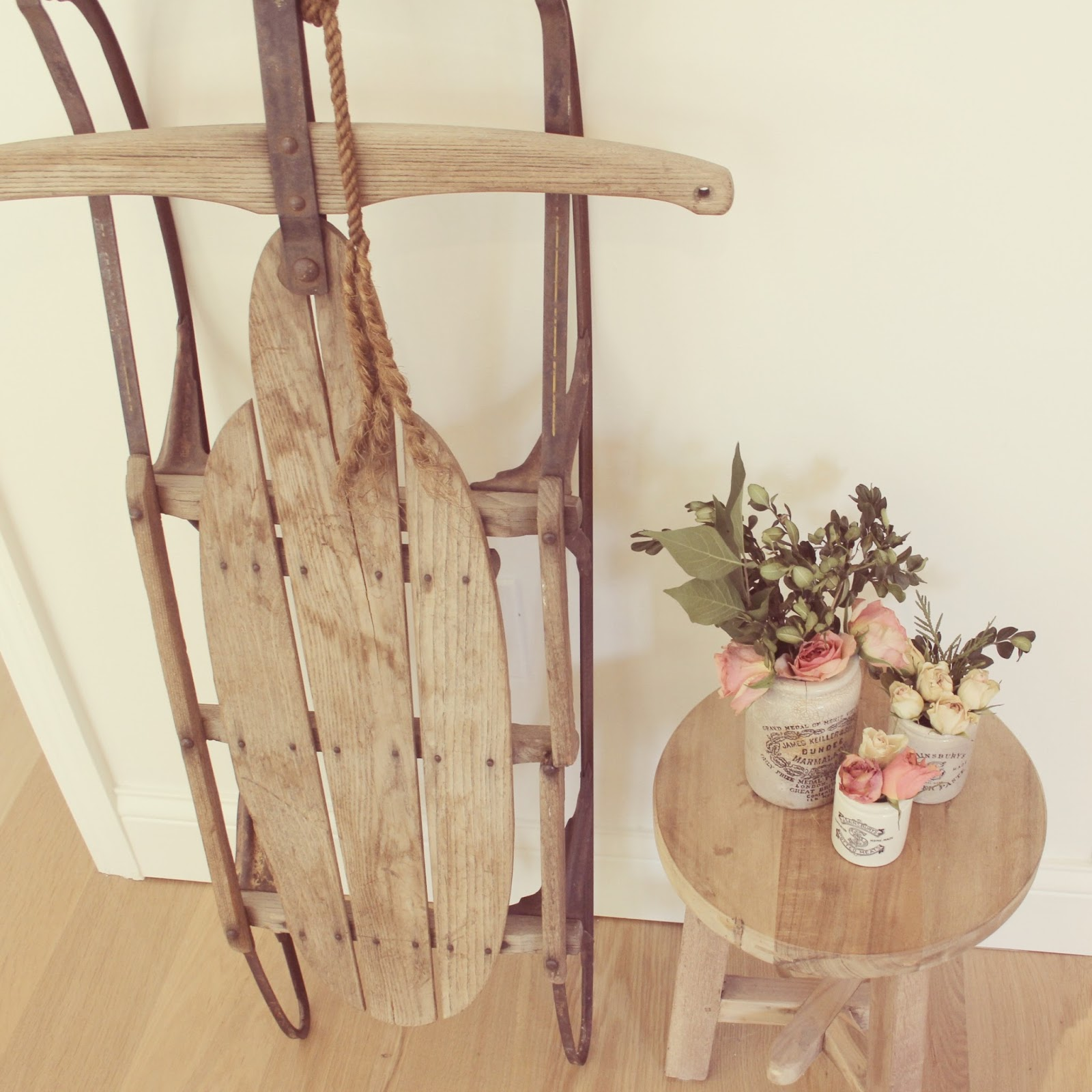 Vintage sled, rustic stool, marmalade jars with flowers