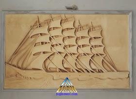 Ukiran relief kapal layar dari batu alam
