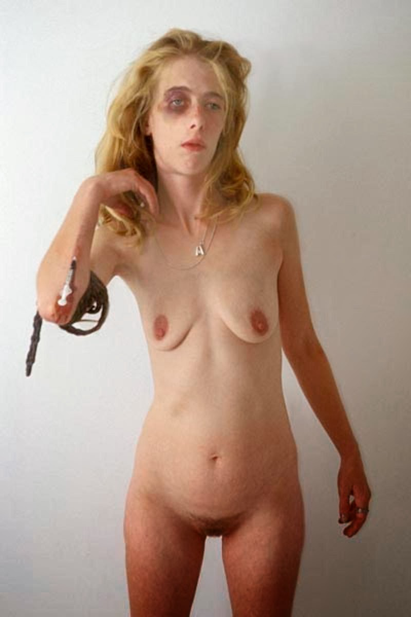 Naked girl in chains