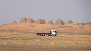 Drives along the road in Meroe
