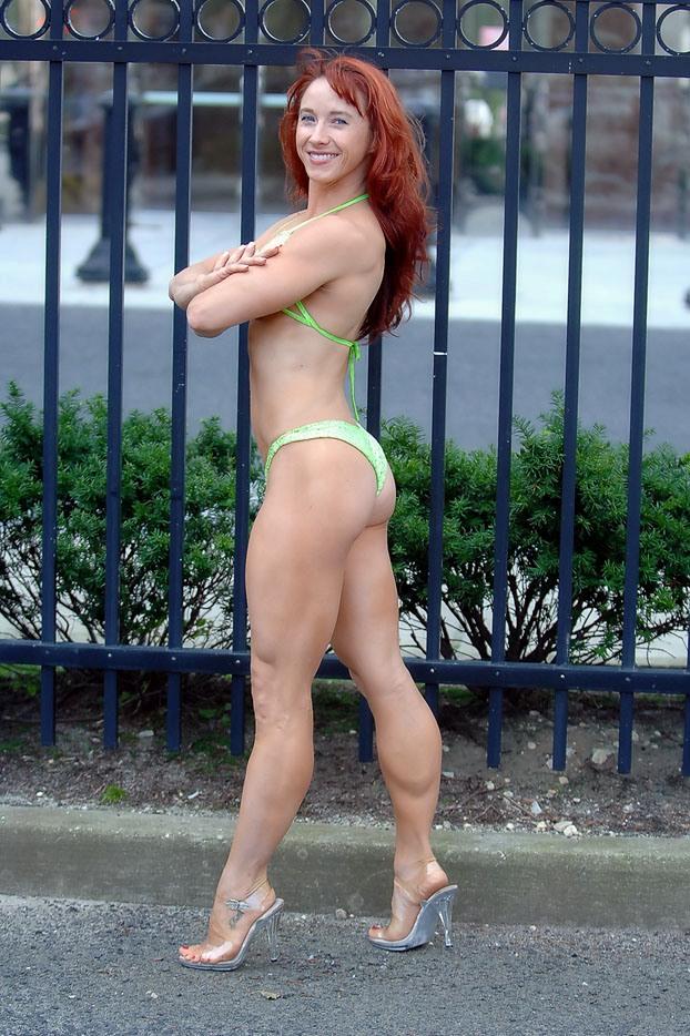 Redhead mature model swimsuit stock photo