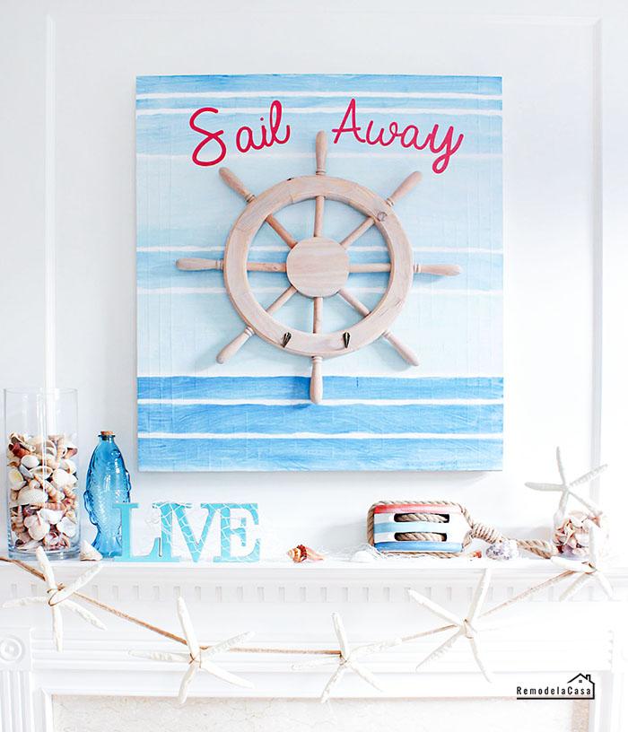 Sail away summer mantel with ship wheel and starfish garland