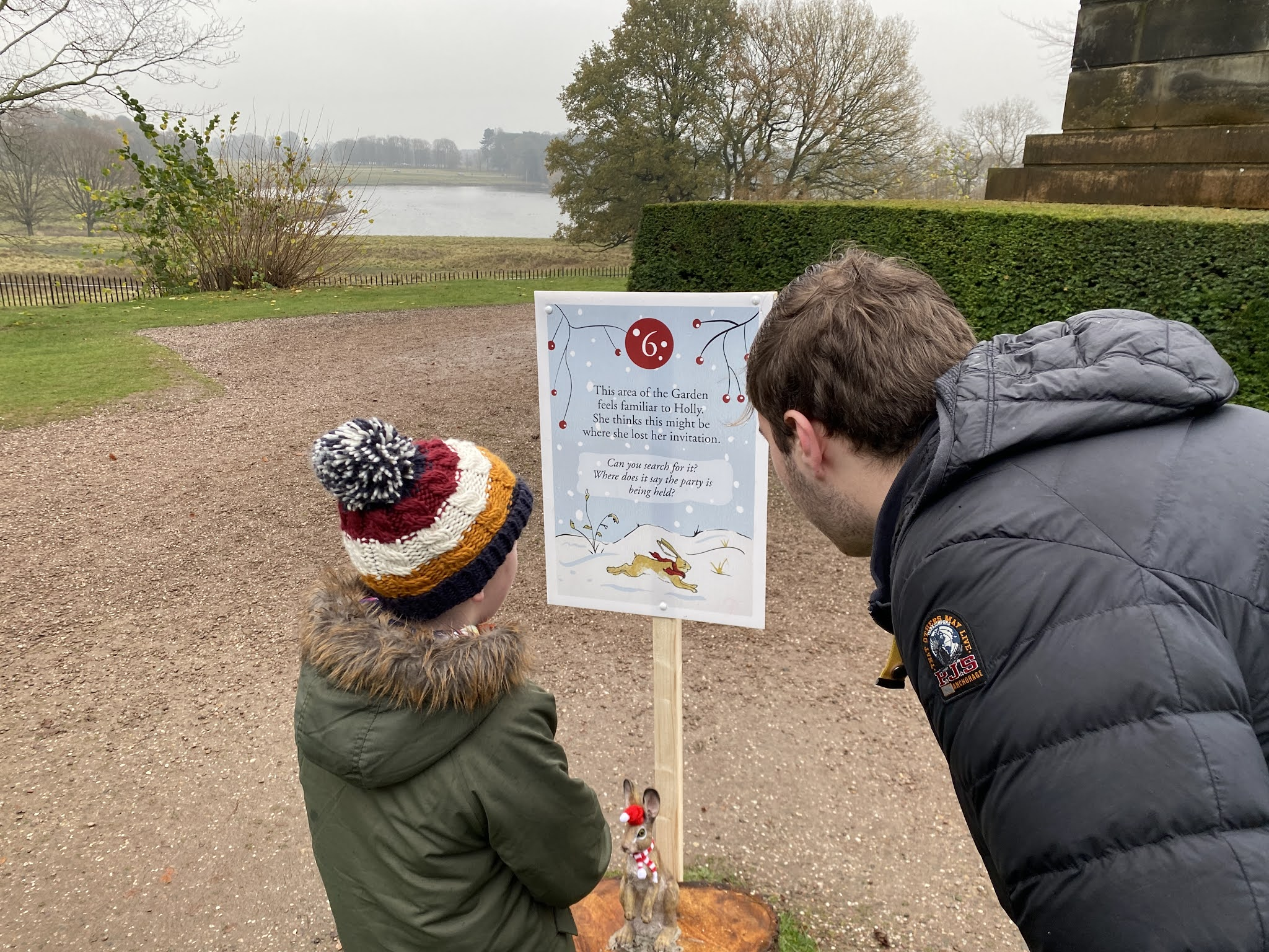 Two boys looking at a clue