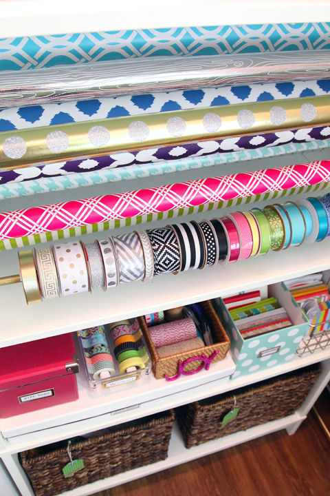 2. A Wrapping Cabinet. Every inch of this gift wrapping cabinet is full of beautiful and functional storage options for all things presents. Check it out!