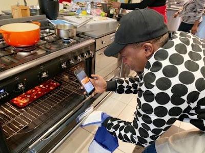 Mthunzi Ntoyi preparing food in oven