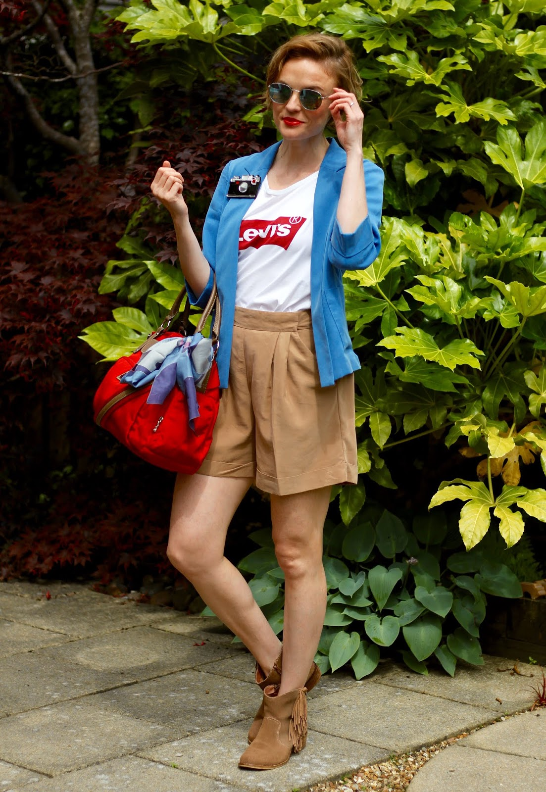 Blue blazer, white slogan tee and beige shorts | Over 40 OOTD