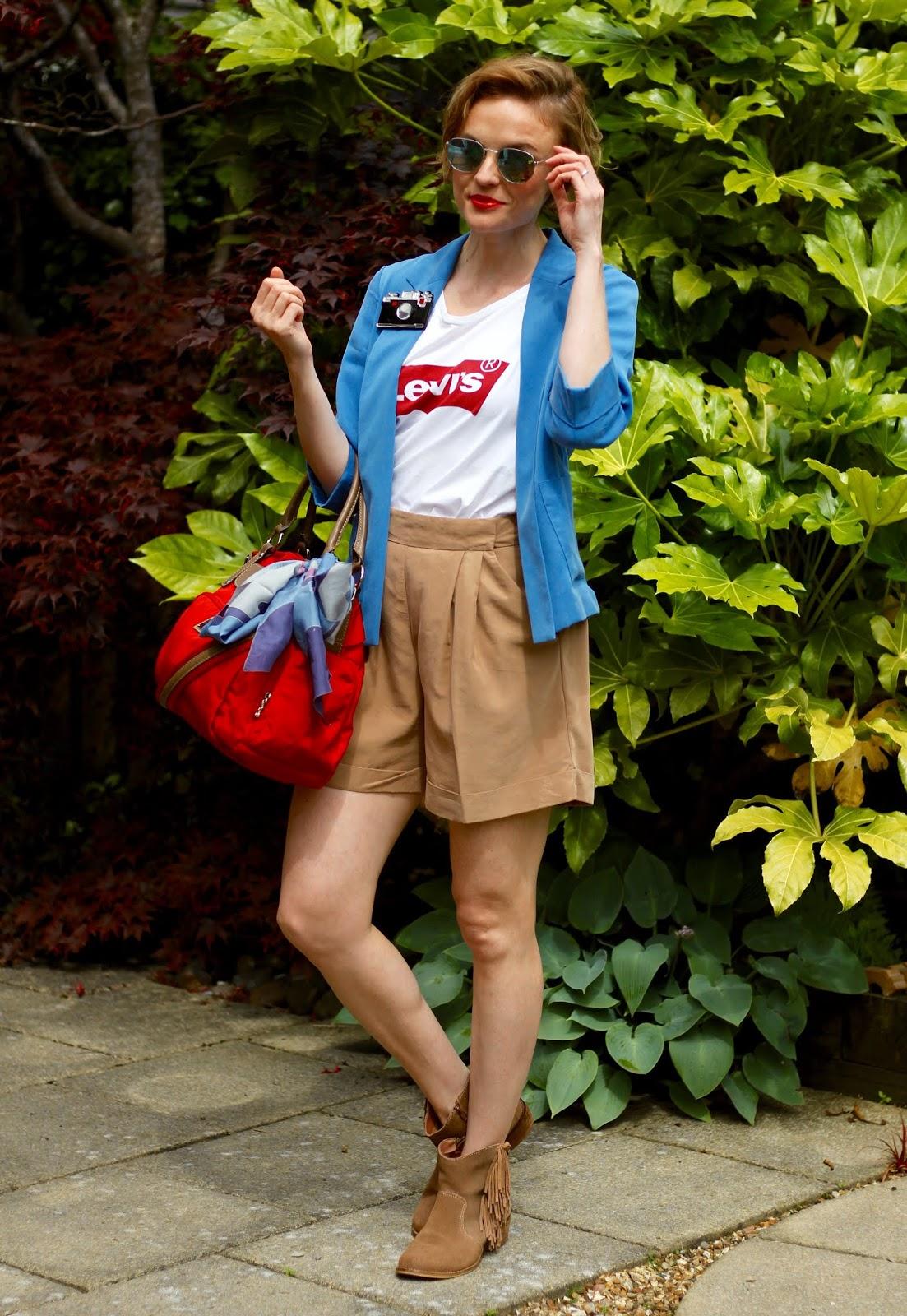 Blue blazer, white slogan tee and beige shorts | Over 40 OOTD