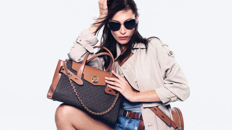 Bella Hadid heads to JFK for MICHAEL Michael Kors' SS2020 Campaign