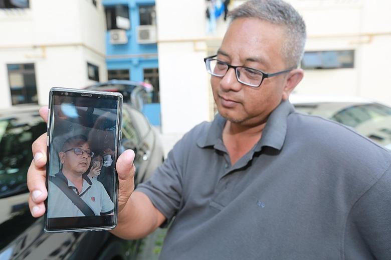 Mr Kamaruzzaman Abdul Latiff showing his viral video.